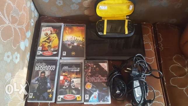 Psp with 5 games and mini toshiba laptop