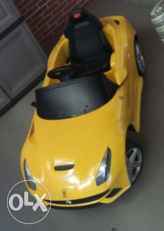 Yellow electrodynamic car for kids