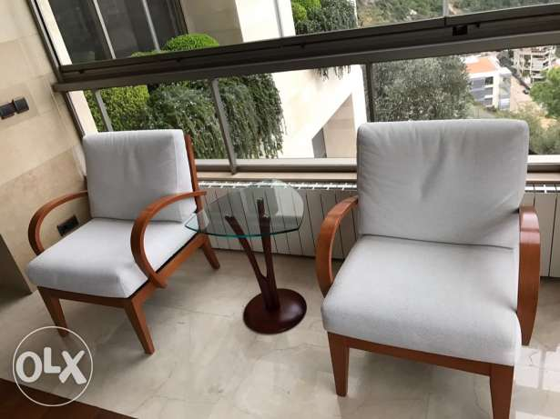 Twin Armchairs with Table المتن -  1