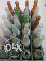 Antique 80's soft drinks bottles with classic case