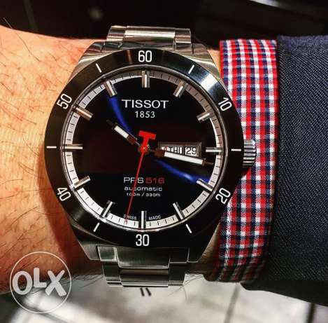 TISSOT - Blue Automatic never used from ABC 900$ (with the warranty)