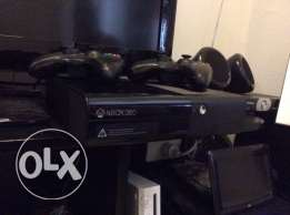 XBOX 360 mosta3maleh chaher 2 controlers 42 cds like new or trade PS4