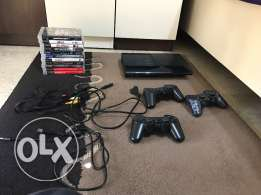 PS3 with 3 joysticks,a charger and 11 games