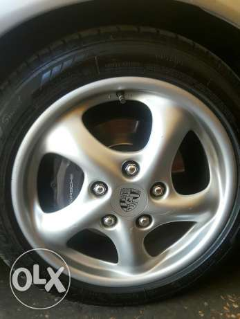 "Porsche boxster 17"" 4 wheels with tires in very good condition,"