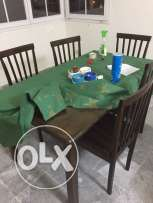 1 large wooden table with 5 chairs