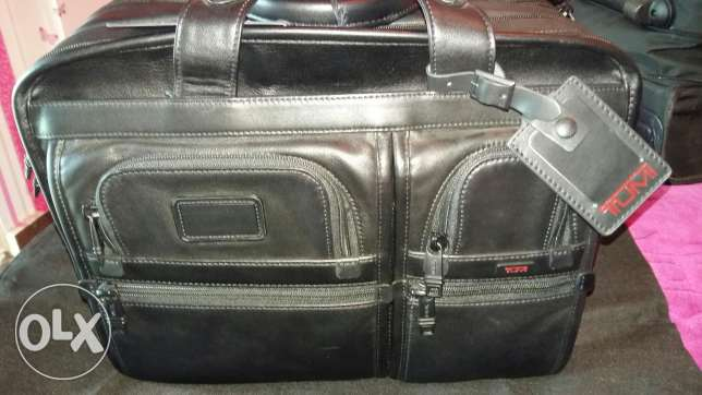 Tumi expendable leather laptop bag