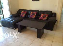 Black leather sofa and coffee table