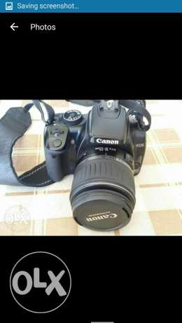 Canon 400D with small camera and 2 extra batteries