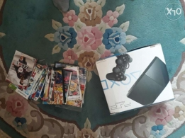 Ps2 with 25 CD's and 4 joy sticks + memory card 8mb