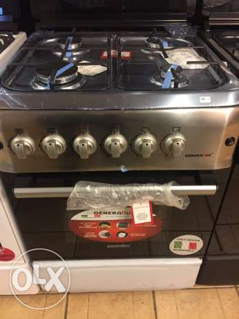 gas oven 4 eyes with one year warranty NEW