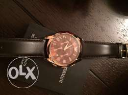 the new EA brown and rose gold leather watch