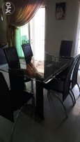 Dinning table with 6 chairs still like new طاولة سفرة او مطبخ جديدة