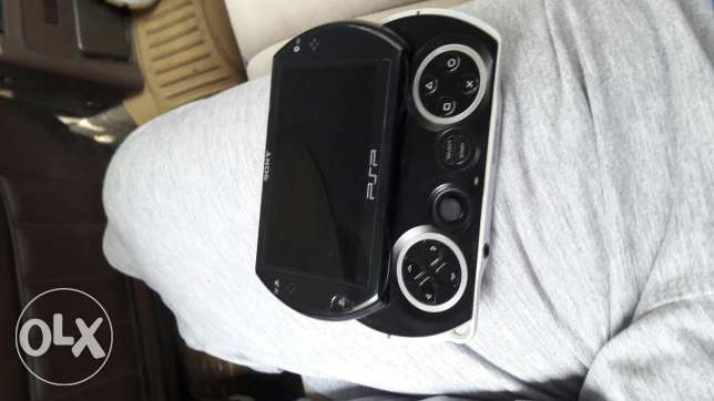 Psp go with cable and 32 games