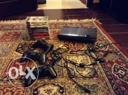 PS3 with 3 joysticks,a charger and 10 ps3 games