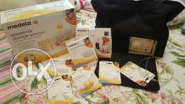 Medela electric double pump, Storage Solutions & Bra for easy express