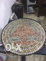 a tabel make from coins and books( coins from all the world and books