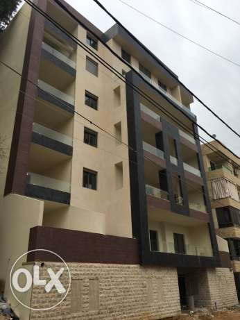 New apartments in Tilal Al-Boucherieh with Unblockable view