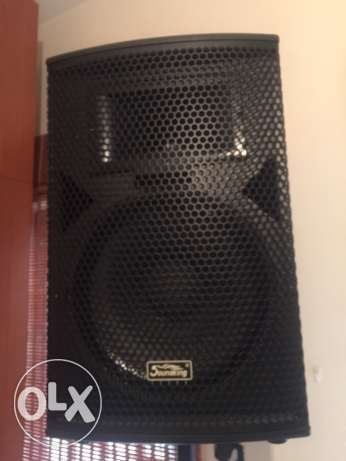 2 soundking speaker wood with base 300$ per1 used for 1 month