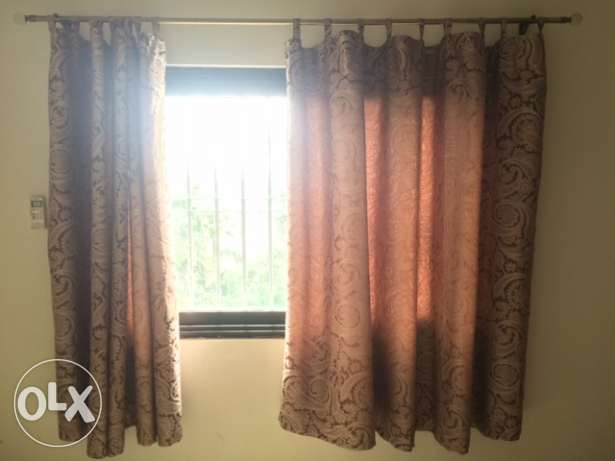 Three Pairs of Brown Curtains
