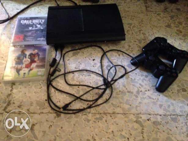 ps3 with 2 controllers and 2 cd 220 alf