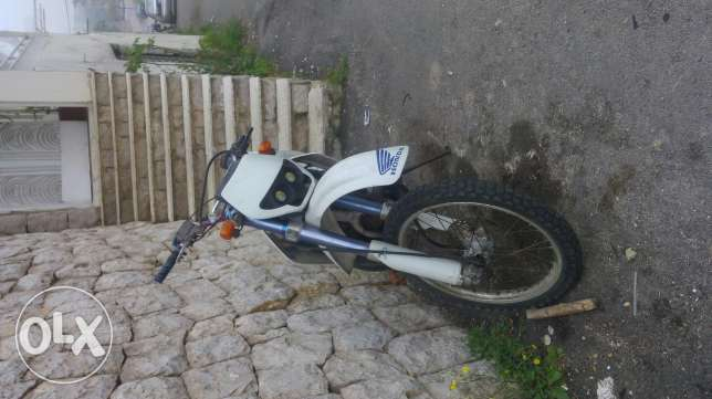 Cross honda 250 for sale or trade 3ala chi bt7