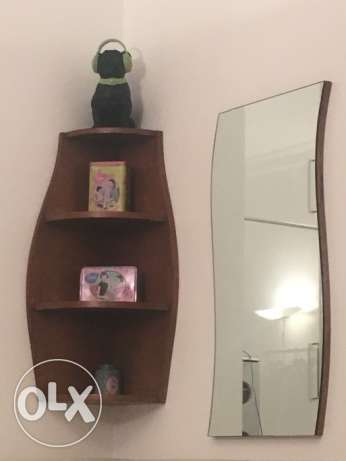 Curved wood shelves with curvy mirror