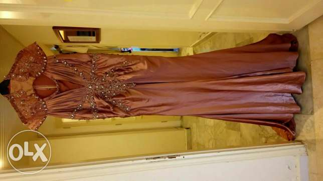 New never worn beaded dress with a tail