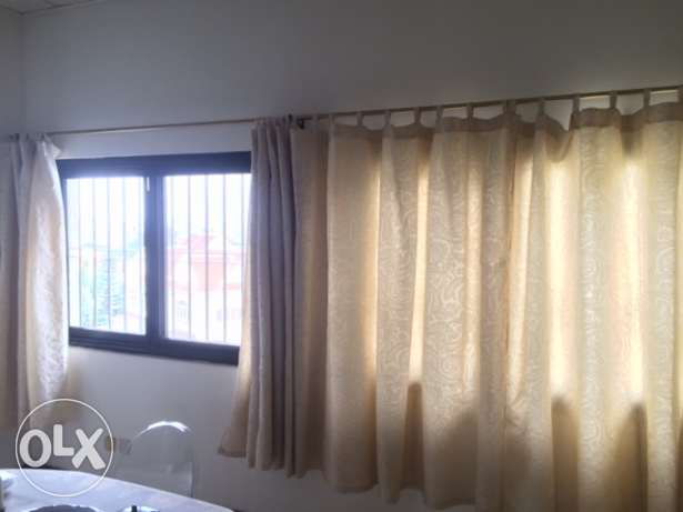 Four Pairs of Beige Curtains