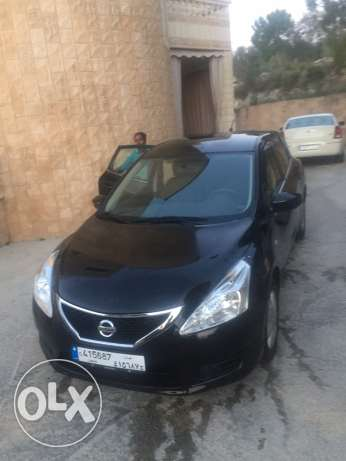 Nissan tida سوبر clean in sold