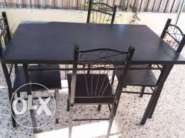 Wooden table with 4 chairs for sale