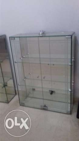 2 new glass cabinet with mirror at back