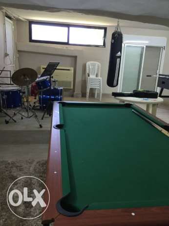 Pool table and soccer table
