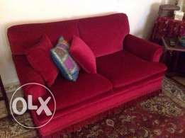 Red Living Room Sofas and wood tables