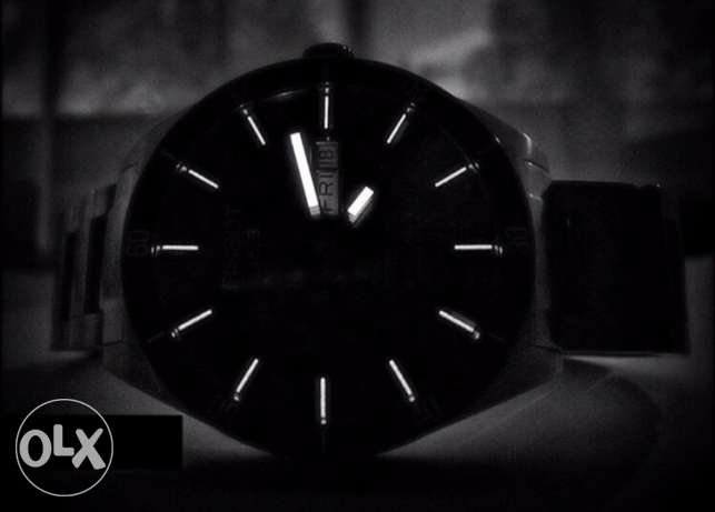 TISSOT Automatic - The dark side of the moon