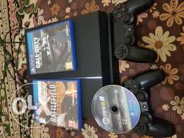Ps4 for sale with 2 controllers and 3cds