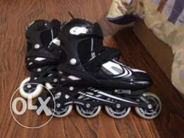 Black & white rollers adjustible size (37,38,39,40