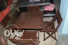 set of solid wood outdoor table chairs
